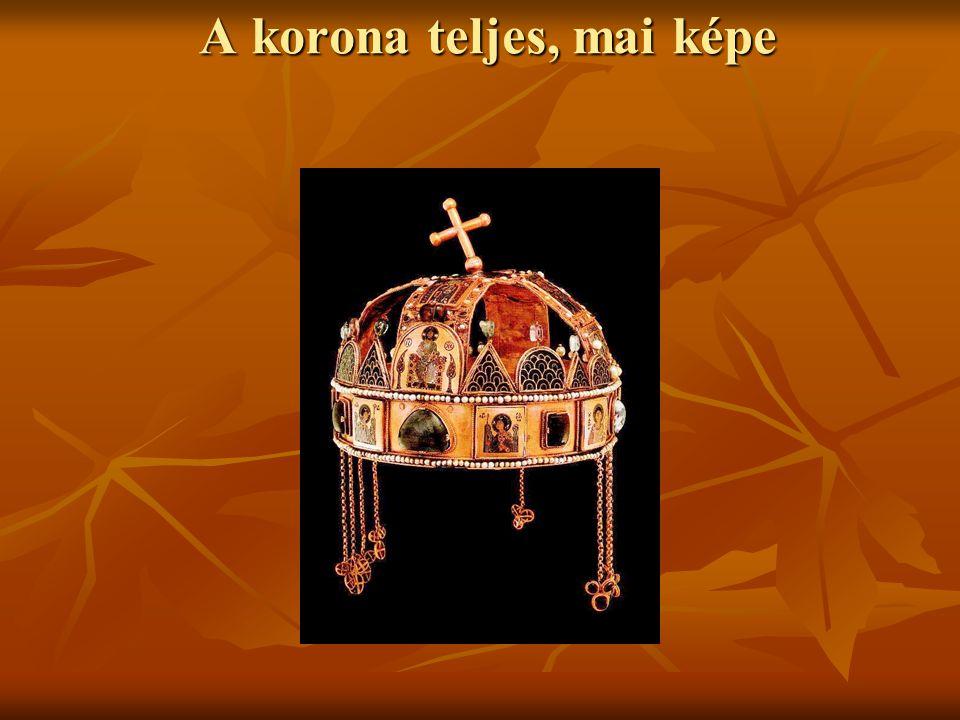 A korona szerkezete A korona két részből áll A korona két részből áll 1) az abroncs = görög korona (corona graeca) 1) az abroncs = görög korona (corona graeca) 2) a felső kereszt alakú pántok = latin korona (corona latina) 2) a felső kereszt alakú pántok = latin korona (corona latina)