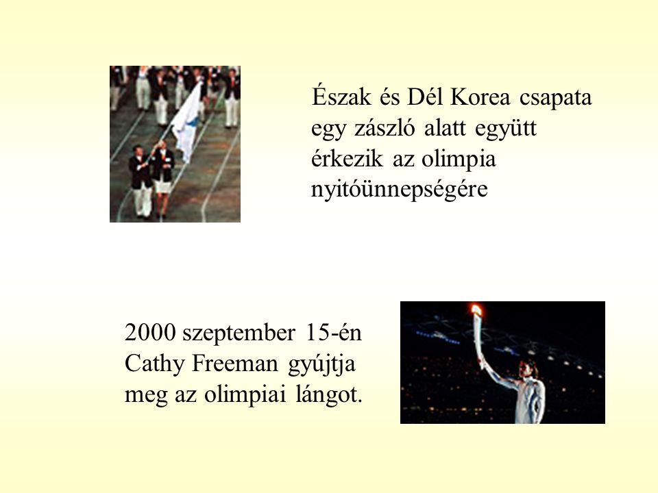 Észak és Dél Korea csapata egy zászló alatt együtt érkezik az olimpia nyitóünnepségére 2000 szeptember 15-én Cathy Freeman gyújtja meg az olimpiai lán
