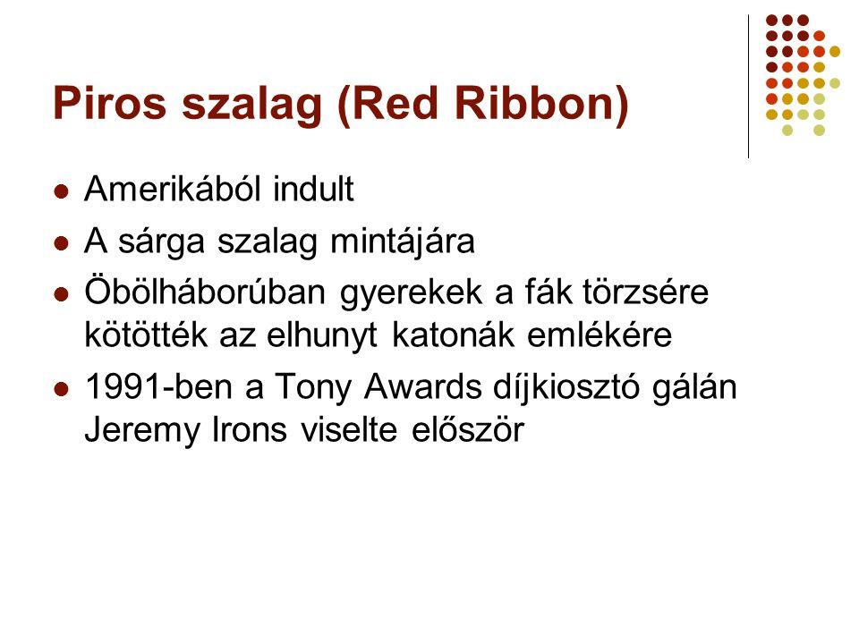 Piros szalag (Red Ribbon) Amerikából indult A sárga szalag mintájára Öbölháborúban gyerekek a fák törzsére kötötték az elhunyt katonák emlékére 1991-ben a Tony Awards díjkiosztó gálán Jeremy Irons viselte először