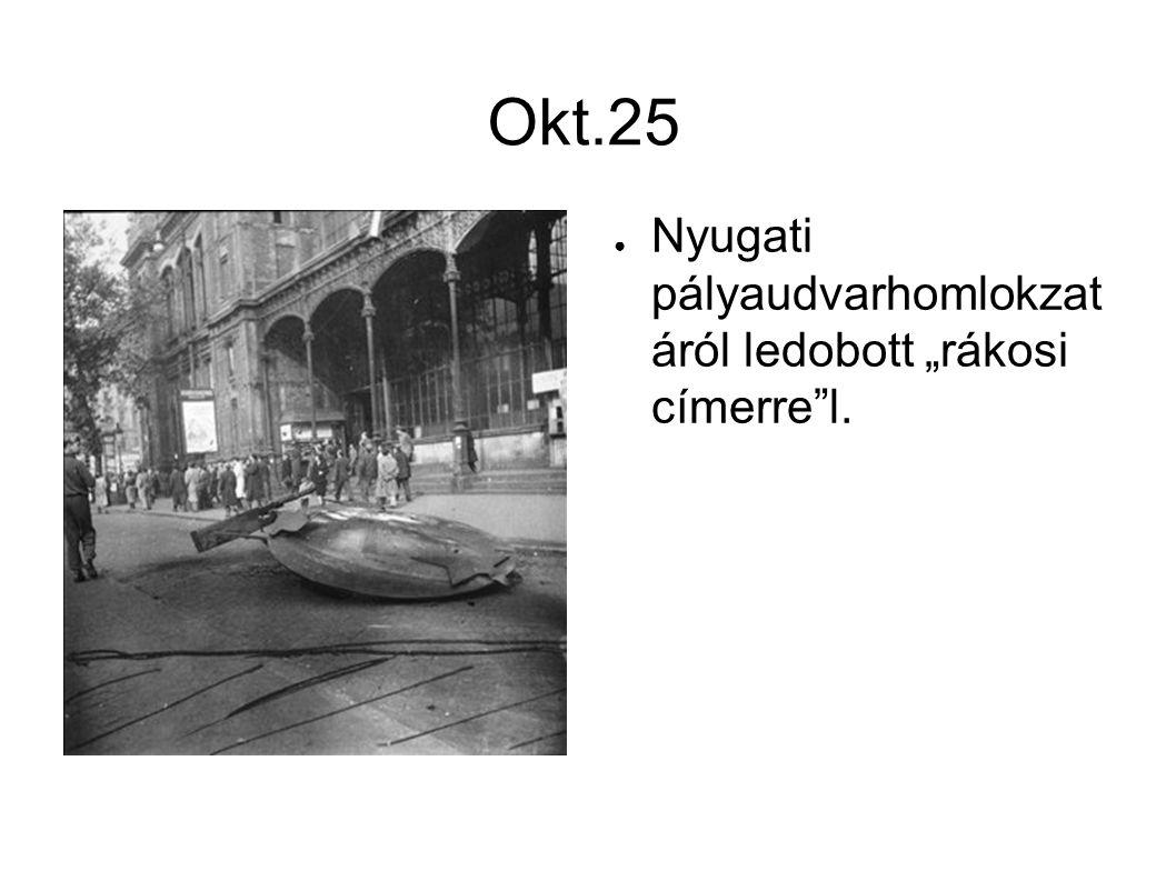 """Okt.25 ● Nyugati pályaudvarhomlokzat áról ledobott """"rákosi címerre""""l."""