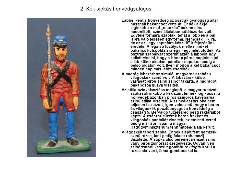 """2. Kék sipkás honvédgyalogos Lábbeliként a honvédség az osztrák gyalogság által használt bakancsot vette át. Ennek alakja leginkább a mai """"munkás"""" bak"""
