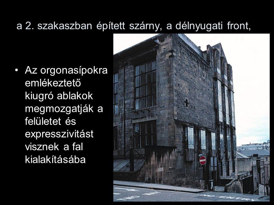 a 2. szakaszban épített szárny, a délnyugati front, Az orgonasípokra emlékeztető kiugró ablakok megmozgatják a felületet és expresszivitást visznek a