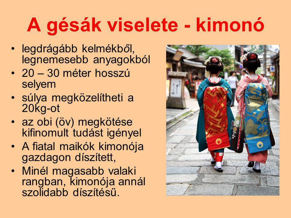 A gésák viselete - kimonó legdrágább kelmékből, legnemesebb anyagokból 20 – 30 méter hosszú selyem súlya megközelítheti a 20kg-ot az obi (öv) megkötése kifinomult tudást igényel A fiatal maikók kimonója gazdagon díszített, Minél magasabb valaki rangban, kimonója annál szolidabb díszítésű.