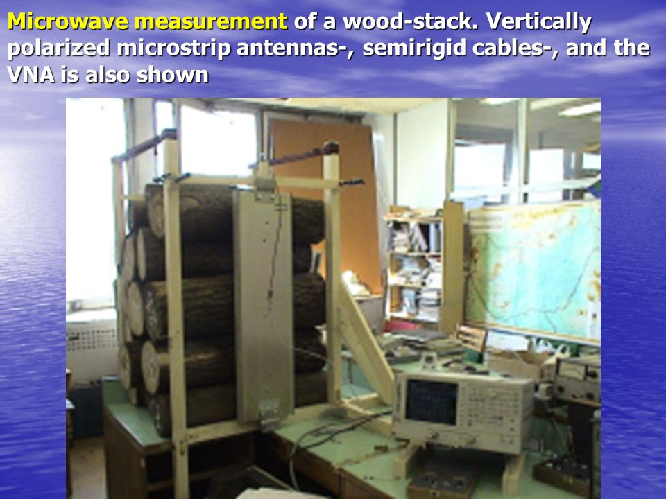 Microwave measurement of a wood-stack. Vertically polarized microstrip antennas-, semirigid cables-, and the VNA is also shown