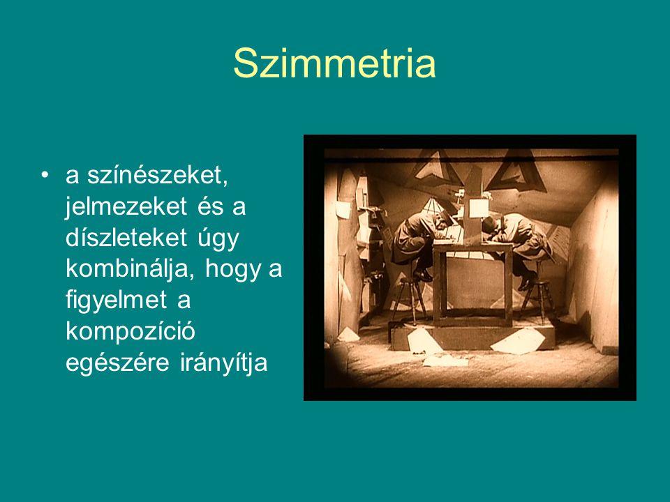 Szimmetria a színészeket, jelmezeket és a díszleteket úgy kombinálja, hogy a figyelmet a kompozíció egészére irányítja