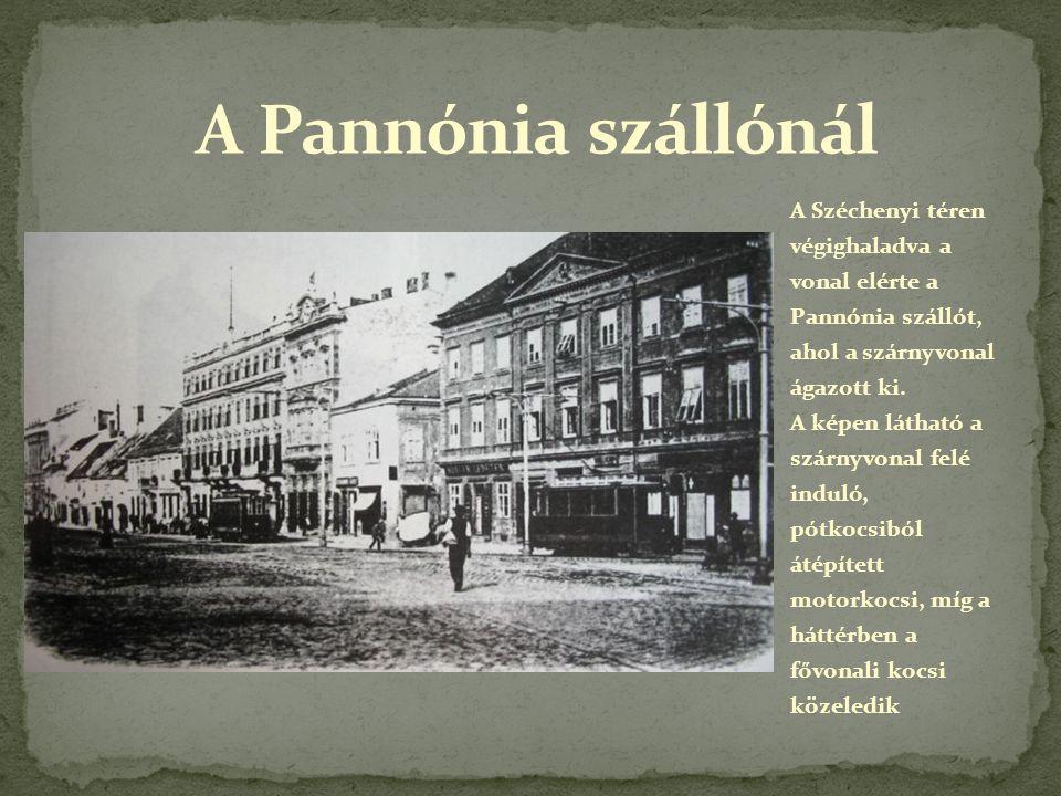 A Széchenyi téren végighaladva a vonal elérte a Pannónia szállót, ahol a szárnyvonal ágazott ki. A képen látható a szárnyvonal felé induló, pótkocsibó