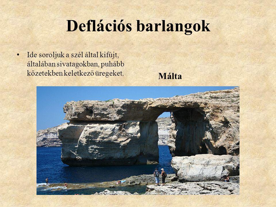 Deflációs barlangok Ide soroljuk a szél által kifújt, általában sivatagokban, puhább kőzetekben keletkező üregeket.